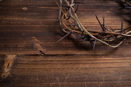 jesus christ crown of thorns: A crown on thorns, a religious symbol on a wooden background - Easter background Stock Photo