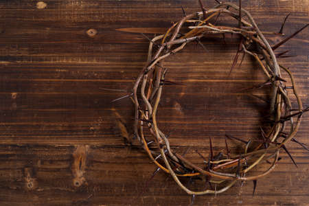 A crown on thorns, a religious symbol on a wooden background - Easter background Stock fotó
