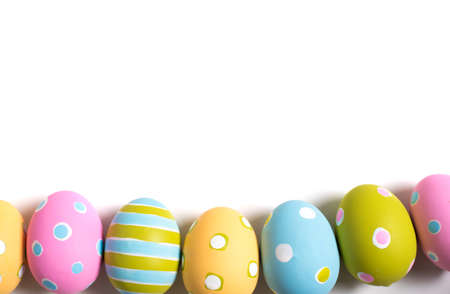 decorated: A group of colorful decorated Easter Eggs on a white background with copy space