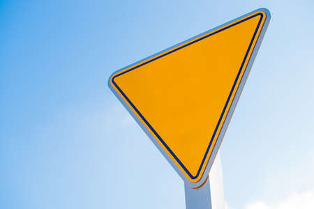 yield sign: A blank yellow yield sign with copy space for text or graphics