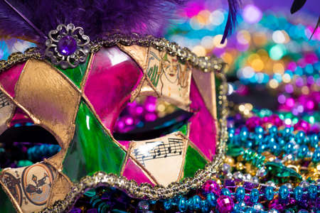 carnivale: A venetian, mardi gras mask or disguise with multi colored beads