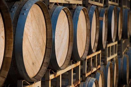 A stack of wine barrels at a vineyard