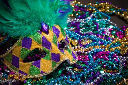 A venetian, mardi gras mask or disguise on a dark background