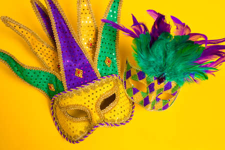 carnivale: A group venetian, mardi gras mask or disguise on a yellow background