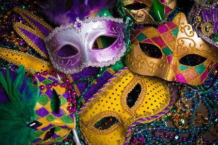 coloured background: A group of venetian, mardi gras mask or disguise on a dark background