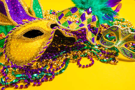 costume jewelry: A venetian, mardi gras mask or disguise on a yellow background Stock Photo
