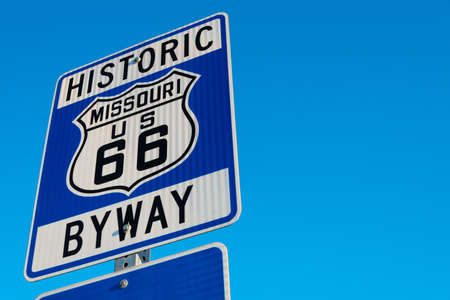 hiway: Historic route 66 highway signs in Missouri USA. Blue sky background Stock Photo