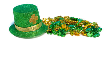 st patricks party: Saint Patricks day decorations with a hat and beads on a white background