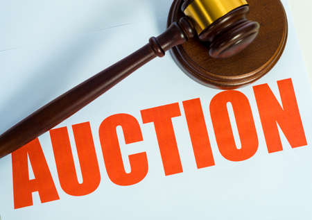 online auction: An auctin sign and wooden mallet on a white background