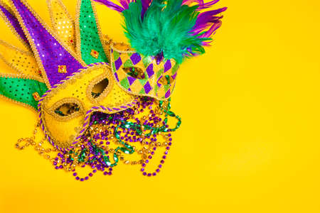 carnivale: A venetian, mardi gras mask or disguise on a yellow background Stock Photo
