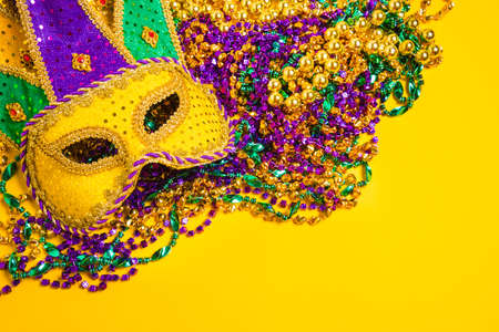 mardi gras background: A venetian, mardi gras mask or disguise on a yellow background Stock Photo
