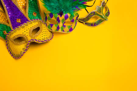 mardi gras: A group venetian, mardi gras mask or disguise on a yellow background