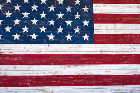 american flag: A painting of an American flag on a wood plank wall