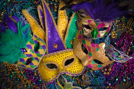 tacky: A venetian, mardi gras mask or disguise on a dark background