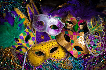 one item: A group of venetian, mardi gras mask or disguise on a dark background