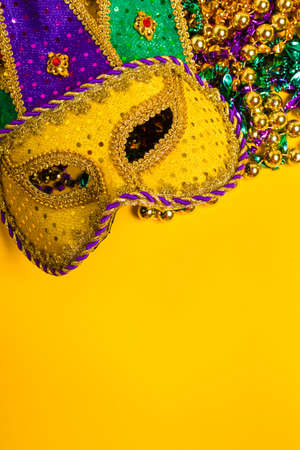 tacky: A venetian, mardi gras mask or disguise on a yellow background Stock Photo
