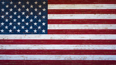 red white and blue: An American or United States flag painted on a wooden plank wall in red, white and blue.