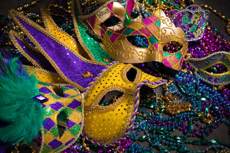 carnivale: A venetian, mardi gras mask or disguise on a dark background