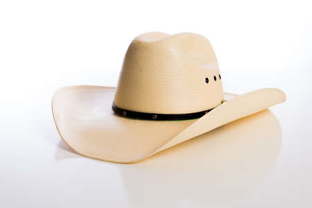 white hat: A straw cowboy hat on a white background Stock Photo