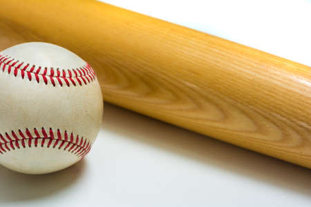 leather ball: Wooden baseball bat on leather ball on white background Stock Photo