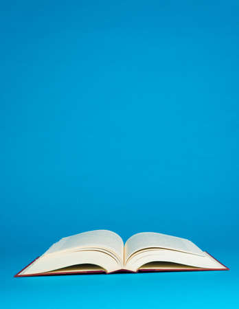 vintage document: Open book on a blue background with copy space