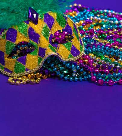 mardi gras mask: Mardi Gras or carnival mask on bright purple background