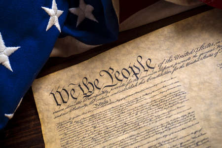 declaration: The constitution of the United States of American with a vintage flag