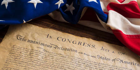 american election: United States Declartion of Independence with vintage flag.  July 4th.