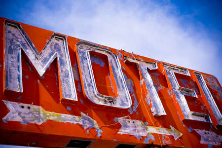 flaking: An old direpit, flaking neon motel sign in the American Desert