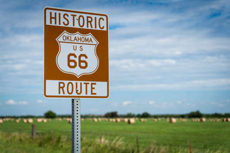 Historic brown and white sign on US Route 66 in Oklahoma