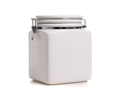 White ceramic cookie Jar on white background with copy space Imagens