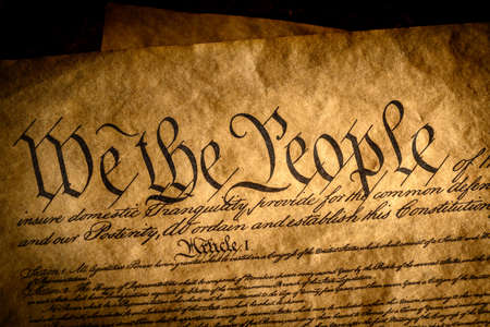 We the People, the beginning of the United States constitution lit by a window light Stock Photo