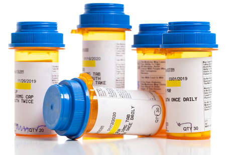 Set of prescriptions. Brown bottles and blue plastic caps on a white background