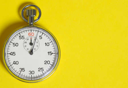 Classic stopwatch on a yellow background