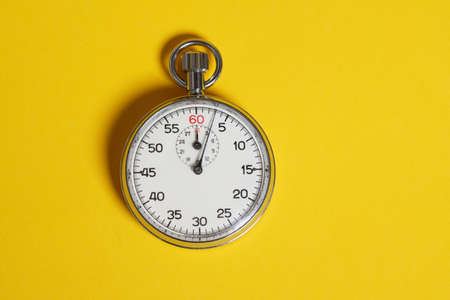 A classic 60 second stopwatch on a yellow background