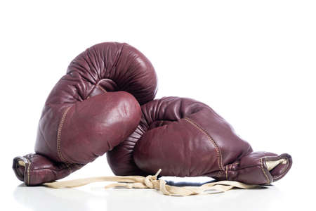 A set of Marion leather vintage boxing gloves on a white background