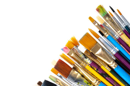 A collection of artists paint brushes on a white background