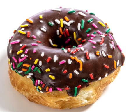 Chocolate glazed donut with sprinkles on a white background