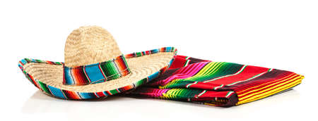 A woven Mexican sombrero or hat with a colorful serape blanket 스톡 콘텐츠