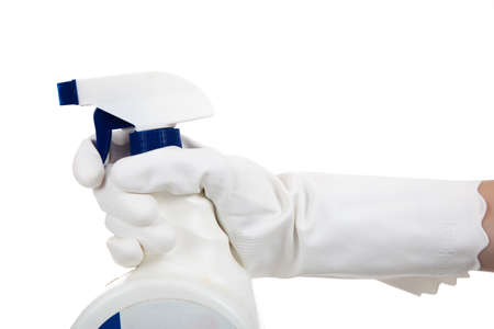 A gloved hands holding a spray bottle of disinfecting chemical on a white background