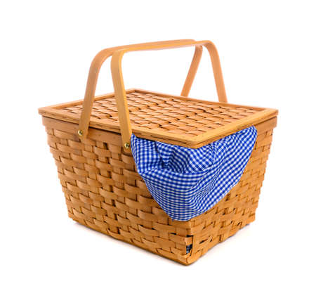 A Picnic basket with blue gingham, checked cloth on white 스톡 콘텐츠