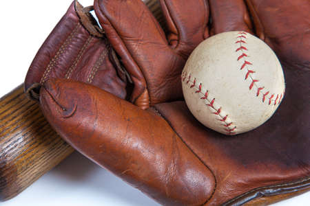 A vintage, antique leather baseball glove and ball and bat on a white background 写真素材