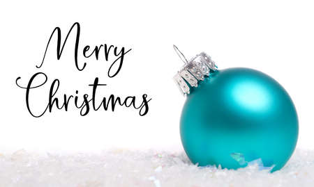 A blue Christmas bauble, ball or decoration on white background