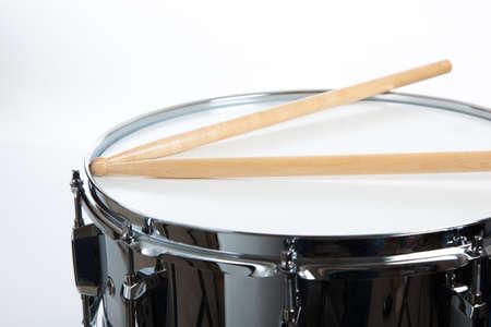 A snare drum with drumsticks on white background Standard-Bild