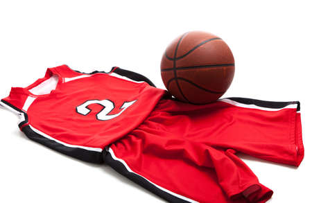 Red basketball uniform on white background with leather ball 스톡 콘텐츠