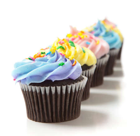 Pastel color cupcakes on a white background. Baking, decoration 스톡 콘텐츠