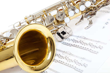 A close up of Saxophone with sheet music 스톡 콘텐츠