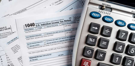 United States tax forms with calculator 스톡 콘텐츠
