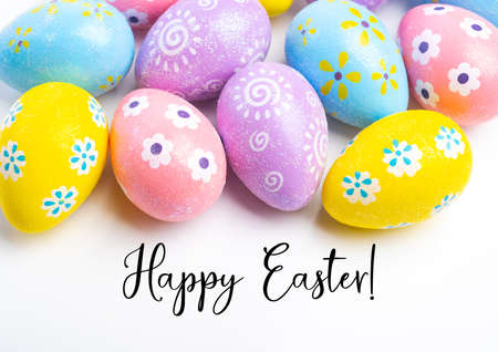 Colorful Easter eggs on white background with greeting