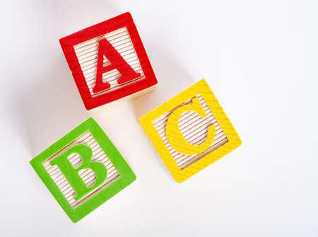 Wooden ABC blocks on white background